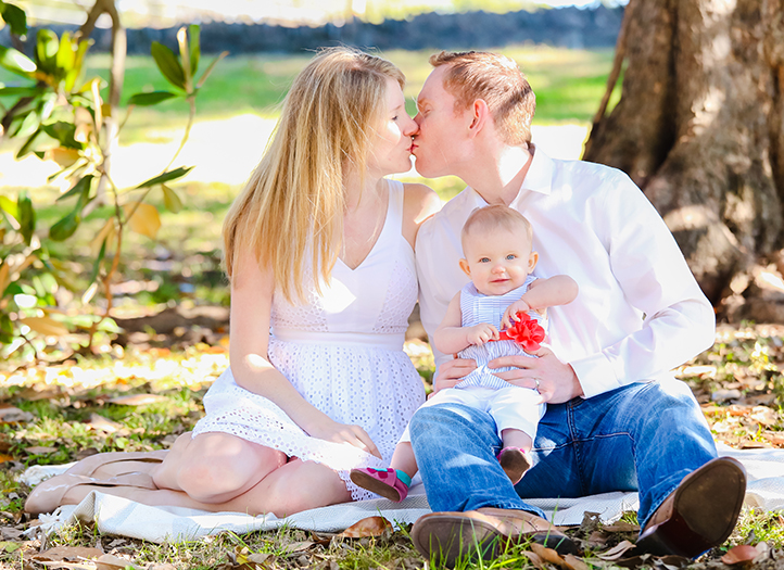 Family with baby having picnic