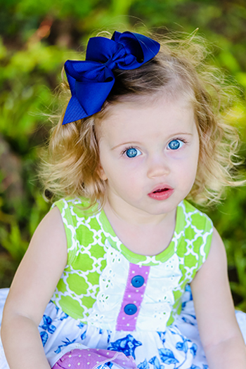 Child with blue eyes posing